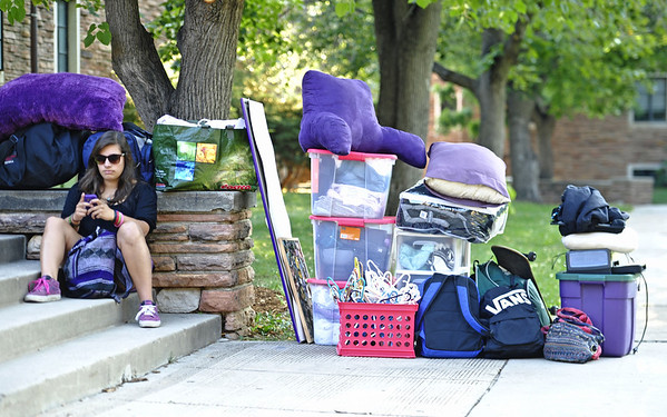 0821MOVE1.jpg Sierra Castillo, freshman in engineering, waits with belongings for Brackett Hall to open so she can move into her dorm room the University of Colorado in Boulder, Colorado August 21, 2011