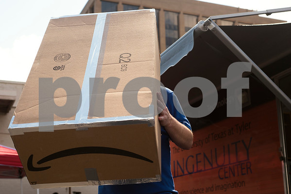 Tim Kennedy, education director at Discovery Science Place and director of UT Tyler's mobile STEM lab, looks at the eclipse through a homemade pinhole viewing box during an eclipse viewing event at Discovery Science Place in Tyler, Texas, on Monday, Aug. 21, 2017. Thousands across East Texas watched the eclipse, which reached peak partial totality around 1:14 p.m. (Chelsea Purgahn/Tyler Morning Telegraph)