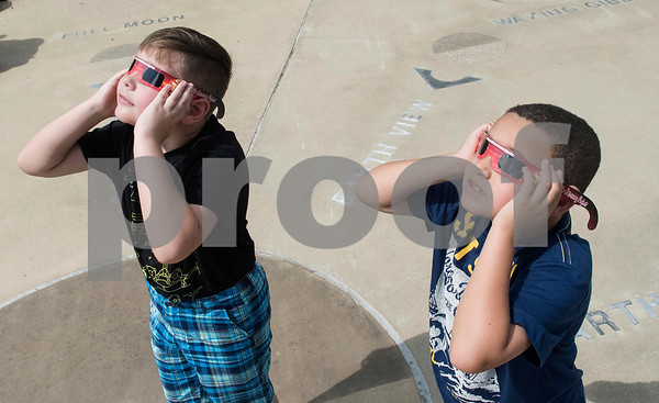 Clifton Early, 8, and Alec Dixon, 7, both of White Oak, look at the eclipse at Tyler Junior College's Center for Earth and Space Science Education Monday Aug. 21, 2017.  (Sarah A. Miller/Tyler Morning Telegraph)