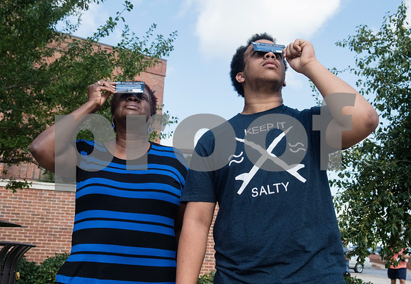 Barbara Smith of Tyler and her grandson Zachary Morrison use free eclipse glasses to look at the sun at Tyler Junior College's Center for Earth and Space Science Education Monday Aug. 21, 2017.  (Sarah A. Miller/Tyler Morning Telegraph)