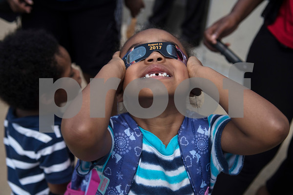 Zoe Serrano, 5, watches the partial solar eclipse seen over Tyler, Texas from the Fair Plaza Parking Garage Monday Aug. 21, 2017.  (Sarah A. Miller/Tyler Morning Telegraph)