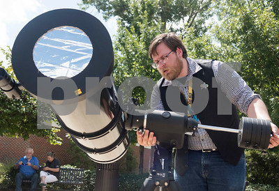 Physics and astronomy professor Doug Parson sets up a telescope fitted with a homemade solar filter to look at the eclipse at Tyler Junior College's Center for Earth and Space Science Education Monday Aug. 21, 2017.  (Sarah A. Miller/Tyler Morning Telegraph)