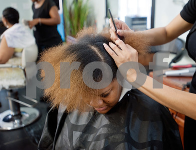 Ashley Dossman has her straightened by stylist Brandee Ware Wednesday Aug. 12, 2015 at Elite Salon in Tyler. Seven stylists work at Elite Salon, 130 N Glenwood Blvd in Tyler.  (Sarah A. Miller/Tyler Morning Telegraph)