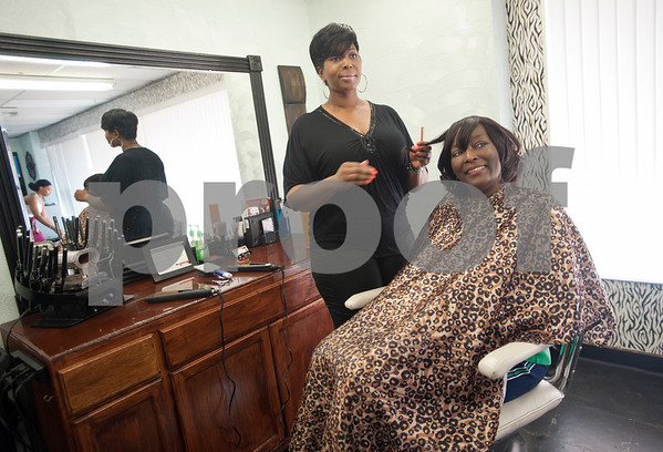 Ann Moore of Tyler has her daughter, professional stylist Temeka Wilson, do her hair Wednesday Aug. 12, 2015 at Elite Salon in Tyler. Seven stylists work at Elite Salon, 130 N Glenwood Blvd in Tyler.  (Sarah A. Miller/Tyler Morning Telegraph)
