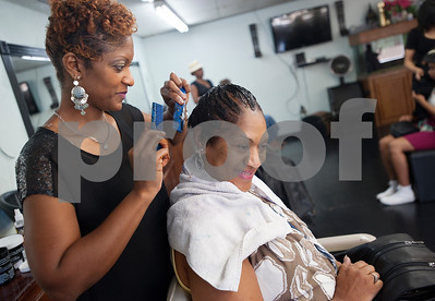 "Melinae Love styles waves into her mother, Dottie Hayes' hair Wednesday Aug. 12, 2015 at Elite Salon in Tyler. ""I'm proud of her,"" Hayes said.  (Sarah A. Miller/Tyler Morning Telegraph)"