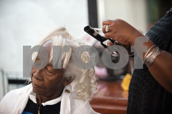 Cora Morgan has her hair curled by her daughter, professional stylist Beverly Johnson, at Elite Salon in Tyler Wednesday Aug. 12, 2015.  (Sarah A. Miller/Tyler Morning Telegraph)