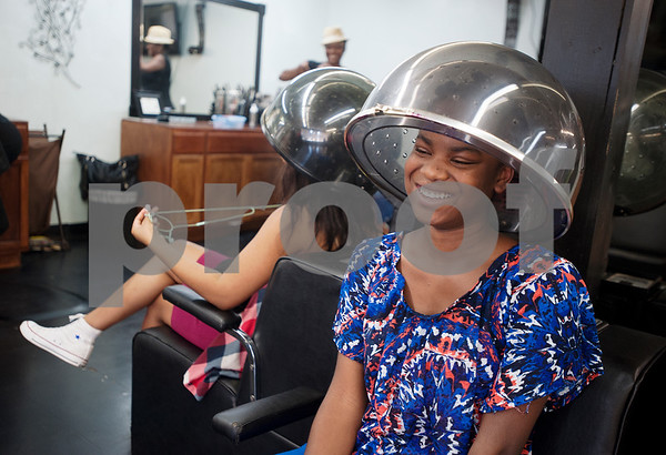 Charmayne Dossman sits under a hair dryer Wednesday Aug. 12, 2015 at Elite Salon in Tyler. Seven stylists work at Elite Salon, 130 N Glenwood Blvd in Tyler.  (Sarah A. Miller/Tyler Morning Telegraph)