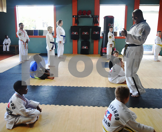 Master Instructor Dr. Dometrius D. Hill, right, leads a taekwondo class at Songahm Martial Arts Academy in Tyler Wednesday August 24, 2016. Hill is also Dean of Students at Tyler Junior College.  (Sarah A. Miller/Tyler Morning Telegraph)