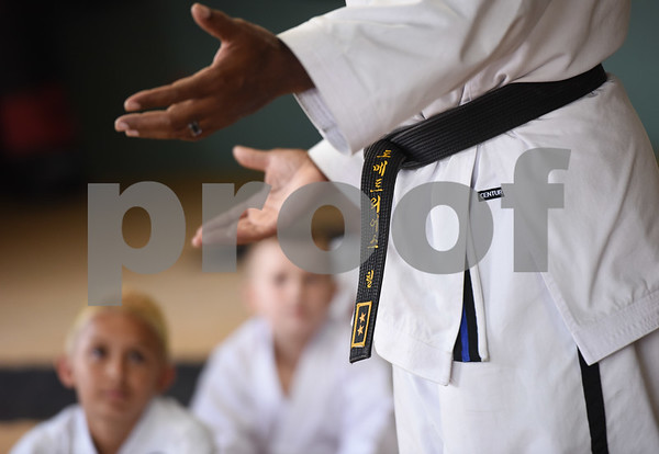 Master Instructor Dr. Dometrius D. Hill, right, speaks to his students about leadership during a taekwondo class at Songahm Martial Arts Academy in Tyler Wednesday August 10, 2016. Hill is also Dean of Students at Tyler Junior College.  (Sarah A. Miller/Tyler Morning Telegraph)