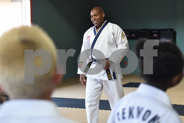 Master Instructor Dr. Dometrius D. Hill speaks to his students during a taekwondo class at Songahm Martial Arts Academy in Tyler Wednesday August 10, 2016. Hill is also Dean of Students at Tyler Junior College.  (Sarah A. Miller/Tyler Morning Telegraph)