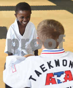 Nygel Chalk, 2, works with Jude Elephant, 8, during a taekwondo class at Songahm Martial Arts Academy in Tyler Wednesday August 10, 2016.   (Sarah A. Miller/Tyler Morning Telegraph)