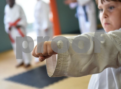 Andy Hall, 6, makes a fist during a taekwondo class at Songahm Martial Arts Academy in Tyler Wednesday August 10, 2016.   (Sarah A. Miller/Tyler Morning Telegraph)