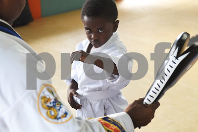 Nygel Chalk, 2, works with Trainee Instructor Jonathan Elledge during a taekwondo class at Songahm Martial Arts Academy in Tyler Wednesday August 10, 2016.   (Sarah A. Miller/Tyler Morning Telegraph)