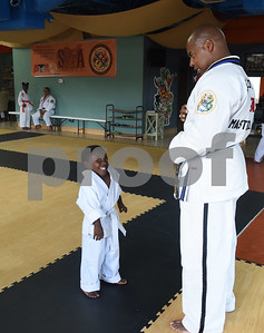 Master Instructor Dr. Dometrius D. Hill speaks student Nygel Chalk, 2, during a taekwondo class at Songahm Martial Arts Academy in Tyler Wednesday August 10, 2016. Hill is also Dean of Students at Tyler Junior College.  (Sarah A. Miller/Tyler Morning Telegraph)