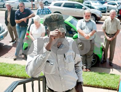 """photo by Sarah A. Miller/Tyler Morning Telegraph  JT Lee of Tyler bows his head in prayer out front of First Baptist Church in downtown Tyler during a celebration of the 50th anniversary of Dr. Martin Luther King Jr.'s """"I Have a Dream"""" speech. The event was put on by members of the Tyler Civic and Church Community. Program participants read portions of the famous speech on the steps of the church."""