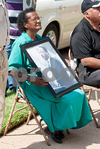 """photo by Sarah A. Miller/Tyler Morning Telegraph  Lola Williams of Tyler sits in front of First Baptist Church in downtown Tyler with a photograph of Dr. Martin Luther King Jr. that she brought from her home for the celebration of the 50th anniversary of Dr. Martin Luther King Jr.'s """"I Have a Dream"""" speech. The event was put on by members of the Tyler Civic and Church Community. Program participants read portions of the famous speech on the steps of the church."""
