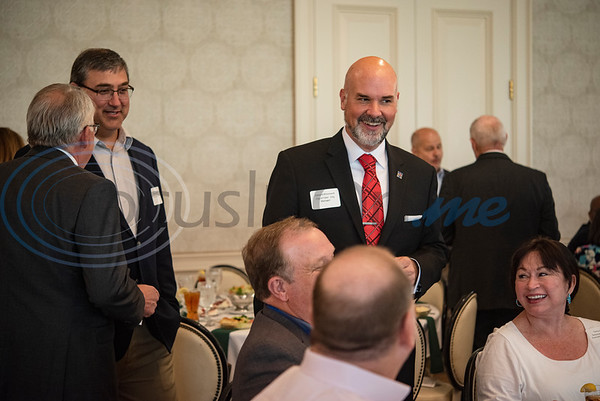 Tyler City Manager Edward Broussard meets with other attendees before the start of the Tyler Area Builders Association Government Officials Appreciation Luncheon held at Willow Brook Country Club on Wednesday Aug. 28, 2019.  (Sarah A. Miller/Tyler Morning Telegraph)