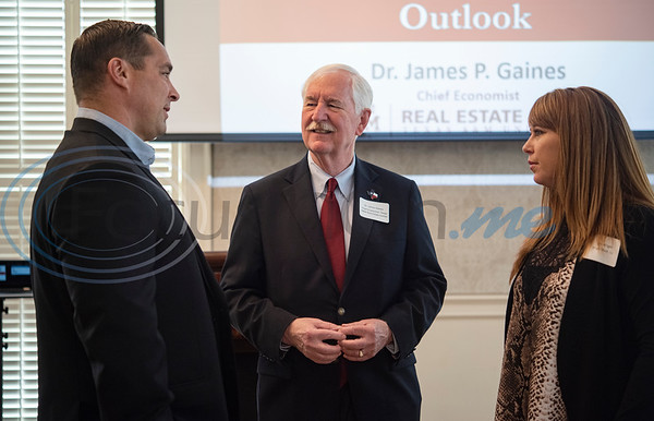 TABA President Trey Hunt, left, Dr. Jim Gaines, center, and TABA Government Relations Committee Chairman Erin Wright, right, speak before the Tyler Area Builders Association Government Officials Appreciation Luncheon held at Willow Brook Country Club on Wednesday Aug. 28, 2019.  (Sarah A. Miller/Tyler Morning Telegraph)