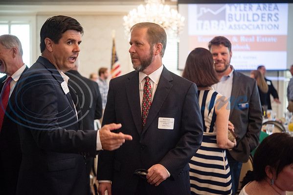 Texas House of Representatives Cole Hefner and Brian Huyle, Chief Justice 12th Court of Appeals, talk before the start of the Tyler Area Builders Association Government Officials Appreciation Luncheon held at Willow Brook Country Club on Wednesday Aug. 28, 2019.   (Sarah A. Miller/Tyler Morning Telegraph)