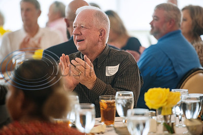 Dennis Walker of Walker and Associates Construction applauds during the Tyler Area Builders Association Government Officials Appreciation Luncheon held at Willow Brook Country Club on Wednesday Aug. 28, 2019.  (Sarah A. Miller/Tyler Morning Telegraph)
