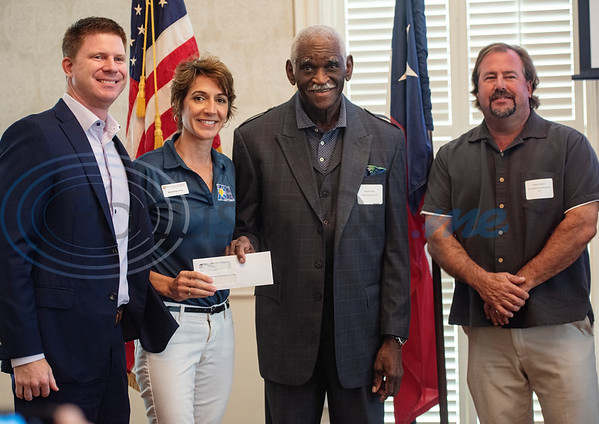 The Cure Starts Now is honored as a 2019 Parade of Homes recipient at the Tyler Area Builders Association Government Officials Appreciation Luncheon held at Willow Brook Country Club on Wednesday Aug. 28, 2019. Pictured from left: Heath Poindexter, Michelle Bjornberg, Jesse Rider and Steve Watson.  (Sarah A. Miller/Tyler Morning Telegraph)