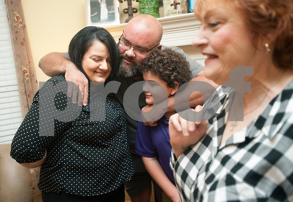 Stacey and Robert Chiasson and Stacy's mother Letty Nunez, right, are pictured in their Tyler home with their youngest son Christian, 11, Thursday Aug. 28, 2015. They evacuated to East Texas during Hurricane Katrina. They lived in St. Bernard Parish.    (Sarah A. Miller/Tyler Morning Telegraph)
