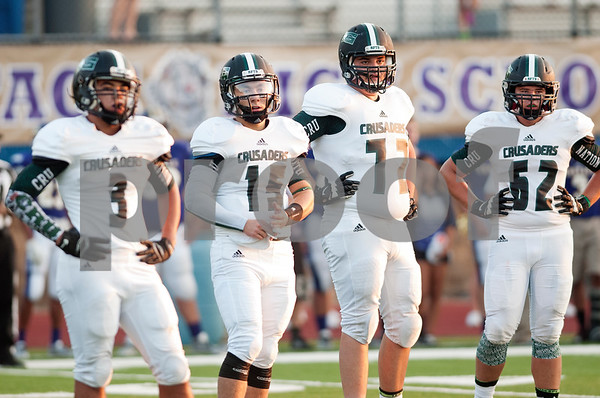 Robbie Chiasson (72) looks for the play with his Bishop T.K. Gorman football teammates during their game against Eustace Friday night Aug. 28, 2015. The Chiasson family evacuated to East Texas during Hurricane Katrina. They lived in St. Bernard Parish.    (Sarah A. Miller/Tyler Morning Telegraph)