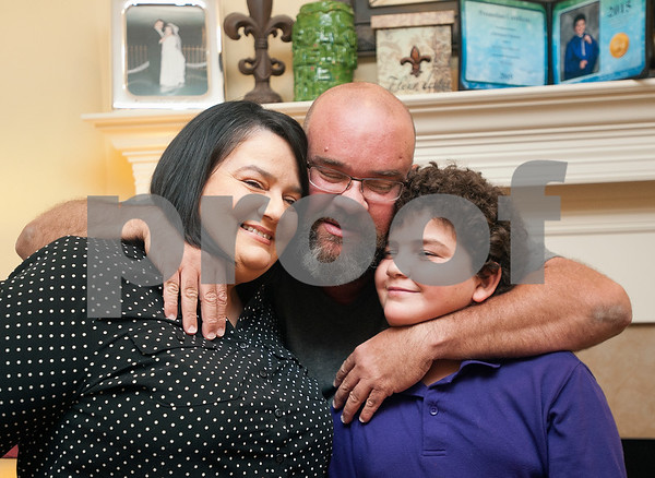 Stacey and Robert Chiasson are pictured in their Tyler home with their youngest son Christian, 11, Thursday Aug. 28, 2015. They evacuated to East Texas during Hurricane Katrina. They lived in St. Bernard Parish.    (Sarah A. Miller/Tyler Morning Telegraph)