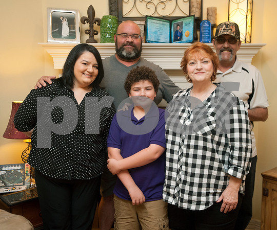 Stacey Chiasson, Robert Chiasson and Christian Chiasson, 11, are pictured at their home with Stacy's mother Letty Nunez and step father Ronald Nunez Thursday Aug. 28, 2015. The family evacuated to East Texas during Hurricane Katrina. They lived in St. Bernard Parish.    (Sarah A. Miller/Tyler Morning Telegraph)