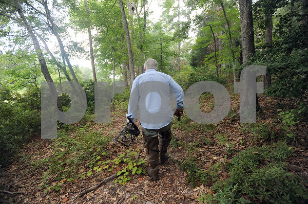 copyright 2012 Sarah A. Miller/Tyler Morning Telegraph  Paul Jones looks for signs of beaver activity in the woods near a dam on private property in south Tyler Thursday.