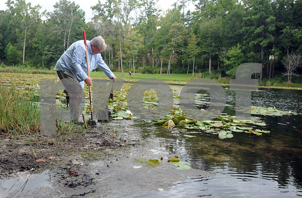 copyright 2012 Sarah A. Miller/Tyler Morning Telegraph  Paul Jones checks one of his beaver traps near a dam on private property in south Tyler Thursday.