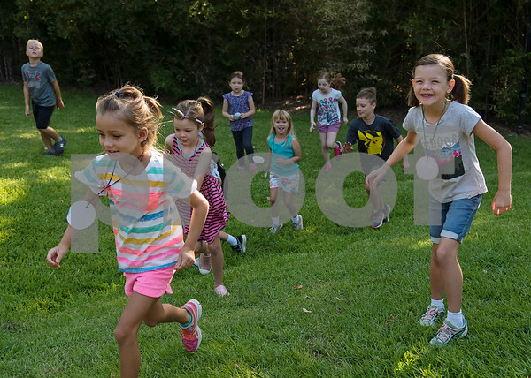 Children enrolled in the zoo's summer camp run to get in line to walk to the bear exhibit at the Caldwell Zoo on Friday Aug. 3, 2018.  (Sarah A. Miller/Tyler Morning Telegraph)