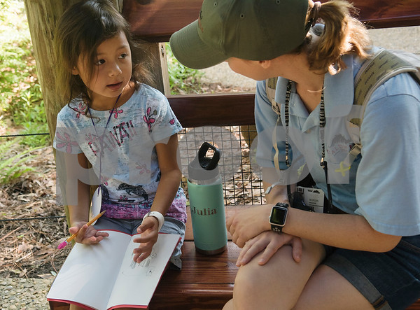 Camper Julia Mitchell, 6, talks with Morgan Armstrong, Director of Visitor Activities and Events at the Caldwell Zoo during the zoo's summer camp on Friday Aug. 3, 2018.  (Sarah A. Miller/Tyler Morning Telegraph)