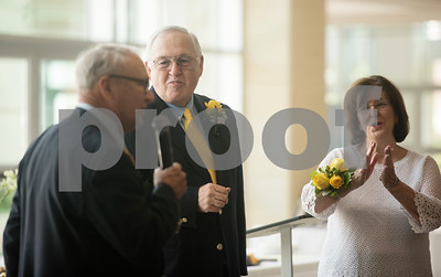 Pastor John Gifford conducts a 50th wedding anniversary vow renewal ceremony for W.H. and Judy Harbour of Tyler at Green Acres Baptist Church on Saturday Aug. 4, 2018. Gifford married the Harbors on Aug. 3, 1968 in Norman, Oklahoma, and it was his first time officiating a wedding.    (Sarah A. Miller/Tyler Morning Telegraph)