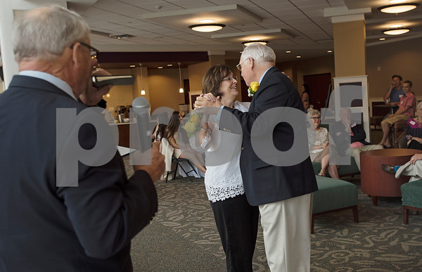 Judy and W.H. Harbour of Tyler dance after pastor John Gifford, at left, finishes their 50th wedding anniversary vow renewal ceremony at Green Acres Baptist Church on Saturday Aug. 4, 2018. Gifford married the Harbors on Aug. 3, 1968 in Norman, Oklahoma, and it was his first time officiating a wedding.    (Sarah A. Miller/Tyler Morning Telegraph)