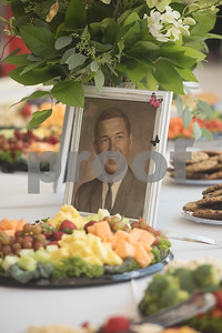 Photos of the long-married couple decorated tables at the the 50th wedding anniversary vow renewal ceremony for Judy and W.H. Harbour of Tyler at Green Acres Baptist Church on Saturday Aug. 4, 2018.  (Sarah A. Miller/Tyler Morning Telegraph)