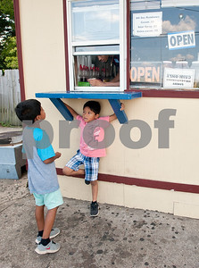 Brothers Joshua Perez, 6, and Manny Perez, 5, wait for their snow cones to be made at Gentry Snowballs in Tyler Tuesday Aug. 4, 2015. Gentry Snowballs is open from noon to 7 p.m. seven days a week during the summer season.    (photo by Sarah A. Miller/Tyler Morning Telegraph)