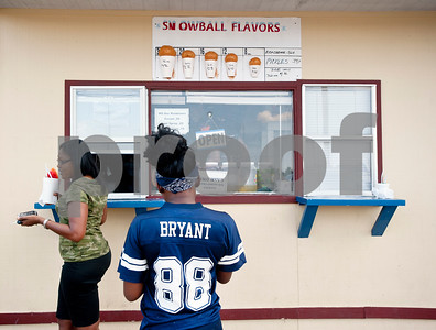 Patrons line up to order snow cones from Gentry Snowballs in Tyler Tuesday Aug. 4, 2015. Gentry Snowballs is open from noon to 7 p.m. seven days a week during the summer season.    (photo by Sarah A. Miller/Tyler Morning Telegraph)