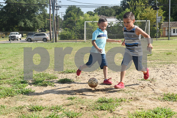 Jesus Cadenas, 5, and Jose Cardenas, 6, play soccer at Hillside Park in Tyler Friday August 5, 2016.  (Sarah A. Miller/Tyler Morning Telegraph)