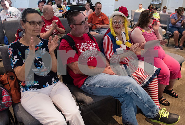 Clown Dee Kirkpatrick of the Tyler-based Rosy Nose Clown Alley sits with residents of Breckenridge Village during a special event Friday Aug. 4, 2017 to celebrate National Clown Week. Breckenridge Village of Tyler (BVT) is a faith-based community for adults with mild to moderate intellectual and developmental disabilities.   (Sarah A. Miller/Tyler Morning Telegraph)