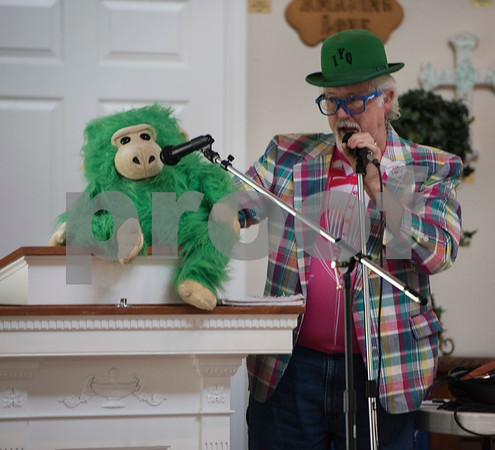 Kit Scott, a member of the Tyler-based Rosy Nose Clown Alley known as Mr. Diddly, performs a song with a puppet inside the chapel at Breckenridge Village Friday Aug. 4, 2017 to celebrate National Clown Week. Breckenridge Village of Tyler (BVT) is a faith-based community for adults with mild to moderate intellectual and developmental disabilities.   (Sarah A. Miller/Tyler Morning Telegraph)