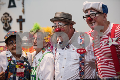 """Members of the Tyler-based Rosy Nose Clown Alley pose for a photograph inside the chapel at Breckenridge Village Friday Aug. 4, 2017 to celebrate National Clown Week. Breckenridge Village of Tyler (BVT) is a faith-based community for adults with mild to moderate intellectual and developmental disabilities. Pictured from left: Shirley """"Daisy Dot"""" Hamilton, Jane """"Plaine Jane"""" Wilson, Randy """"Abnor"""" Ainsworth and Hezekiah """"Wiz Bang"""" Ainsworth.  (Sarah A. Miller/Tyler Morning Telegraph)"""