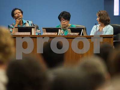 Tyler ISD board members Orenthia Mason, left, and Patricia Nation, right, listen as Jean Washington speaks during a specialty called Tyler Independent School District meeting where a vote on whether or not to change the name of Robert E. Lee High School was on the agenda is adjourned. The motion to vote died after failing to gain a second motion.   (Sarah A. Miller/Tyler Morning Telegraph)