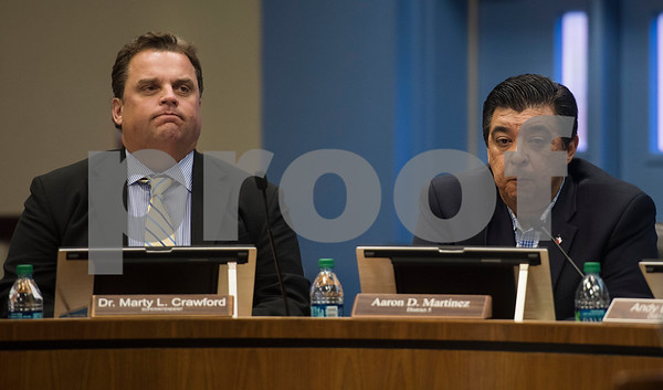 Tyler ISD Superintendent Dr. Marty Crawford and board member Aaron Martinez react as board president Fritz Hager (not pictured) speaks during a specialty called Tyler Independent School District meeting where a vote on whether or not to change the name of Robert E. Lee High School was on the agenda. The motion to vote died after failing to gain a second motion during the meeting at the Jim Plyler Instructional Complex in Tyler, Texas.   (Sarah A. Miller/Tyler Morning Telegraph)
