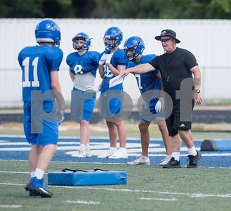 Grace Community School head football coach Norm Thompson leads a drill at practice on Tuesday Aug. 7, 2018 at Clyde-Perkins Stadium.  (Sarah A. Miller/Tyler Morning Telegraph)