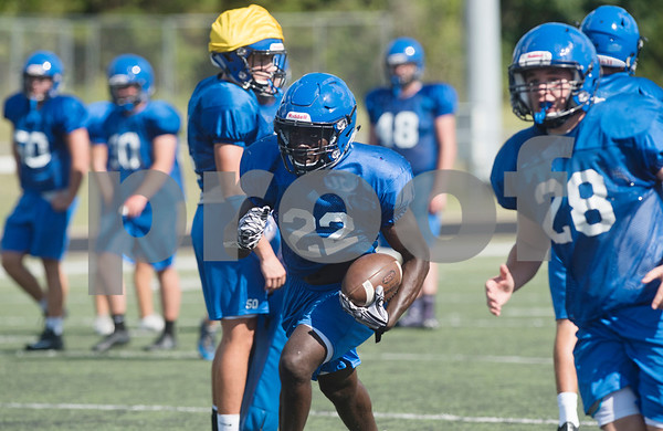 Grace Community School football player Uchenna Uduma carries the ball in a play during practice on Tuesday Aug. 7, 2018.  (Sarah A. Miller/Tyler Morning Telegraph)