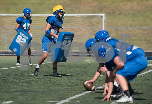 Football players run a drill during football practice at Grace Community School on Tuesday Aug. 7, 2018.  (Sarah A. Miller/Tyler Morning Telegraph)