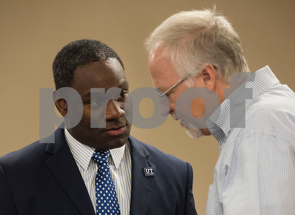 University of Texas at Tyler President Dr. Michael V. Tidwell and Tyler Mayor Martin Heines talk before a discussion with Texas Governor Greg Abbott at New Days Community Church in Tyler on Wednesday Aug. 8, 2018. The roundtable discussion was part of a campaign stop that focused on education and economic opportunities in the African American community.  (Sarah A. Miller/Tyler Morning Telegraph)