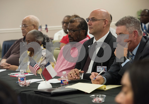 Whitehouse ISD Superintendent Chris Moran, second from right, attends Texas Governor Greg Abbott's campaign stop roundtable discussion on education and economic opportunities in the African American community at New Days Community Church in Tyler on Wednesday Aug. 8, 2018.  (Sarah A. Miller/Tyler Morning Telegraph)