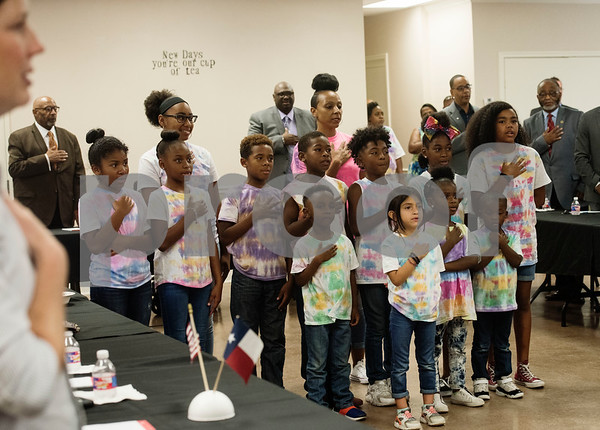 Children from the Journeys of the Heart after school program lead Texas Governor Greg Abbott and those attending his campaign stop roundtable discussion in the Pledge of Allegiance at New Days Community Church in Tyler on Wednesday Aug. 8, 2018. The roundtable discussion was on education and economic opportunities in the African American community.  (Sarah A. Miller/Tyler Morning Telegraph)